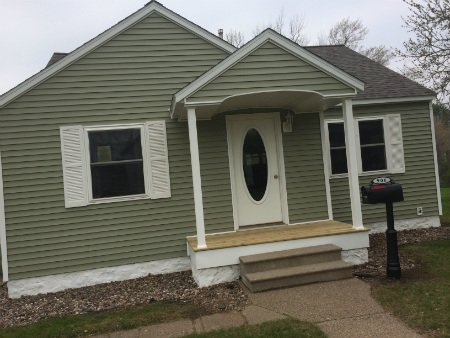 Photo of house with green siding